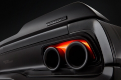 "The lower exhaust tips of the 1968 Dodge ""Super Charger"" are eliminated and replaced with Alfa Romeo Stelvio 5-inch dual-walled tips re-engineered to run through the taillamp housing. Brake lights have been uniquely reconfigured with LED lights to glow around the exhaust tips."